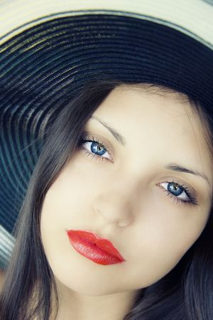 The beautiful girl in a hat Stock Photo - 5575210