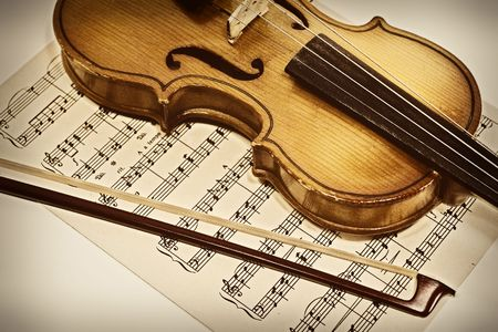 violins: Old violin and musical notes