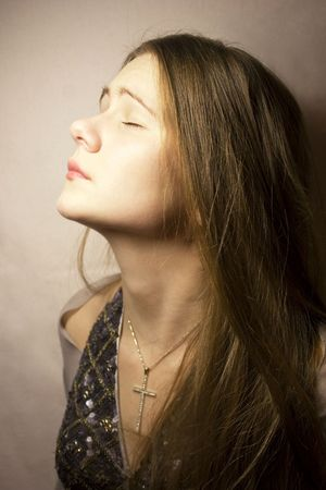 blindly: Portrait of the young girl with closed eyes Stock Photo