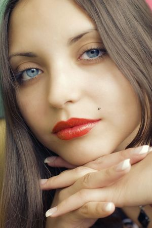 face of young beautiful brunette woman photo