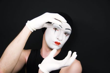 Portrait of mime in white gloves photo