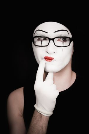 mime: thoughtful portret of the mime on a black background