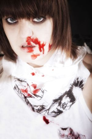 smeared hand: Portrait of  young woman with  bloodstained face Stock Photo