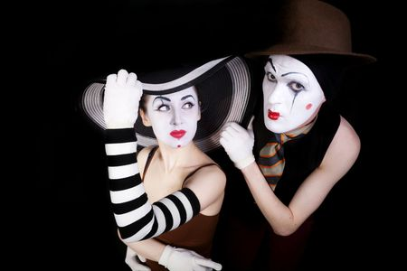 Portrait of two mimes in white gloves on black background photo