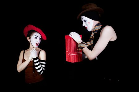 gives: man  mime gives to the woman  gift in  red box