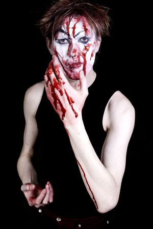 bloody mime on a black background photo