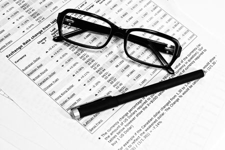 undersign: Glasses, financial documents and pencil