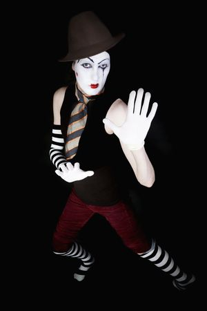 mime in  hat,  tie and white gloves on  black background photo