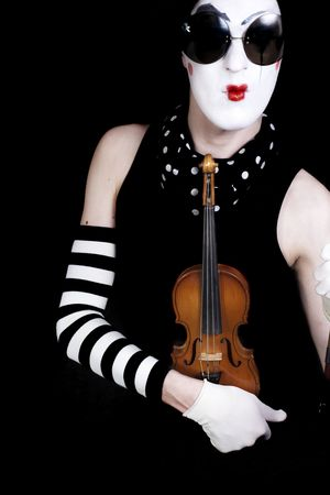 mime with  violin and sunglasses on  black background photo
