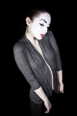 Sad woman  mime in  grey jacket on  black background Stock Photo - 6371477