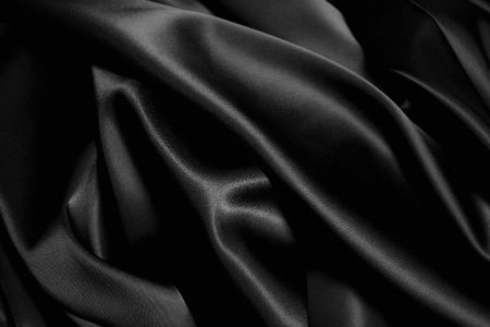 black silk: texture of a black  satin close up Stock Photo