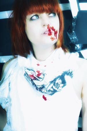 smeared hand: Portrait of young woman with blood on face Stock Photo