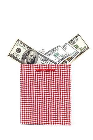 Red Gift package with dollars isolated on  white background photo