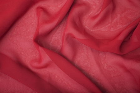 Texture of red satin silk close up photo