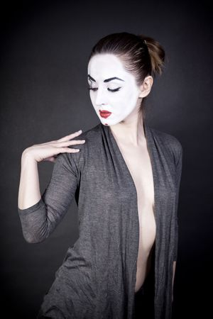 female mime in  gray jacket on  black background photo