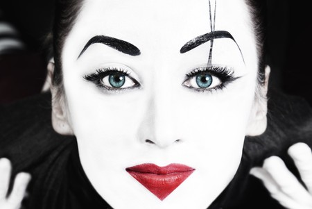 parody: A face of beautiful woman mime with blue eyes  close up