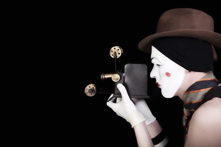 portrait of mime in white gloves and brown hat with camera photo