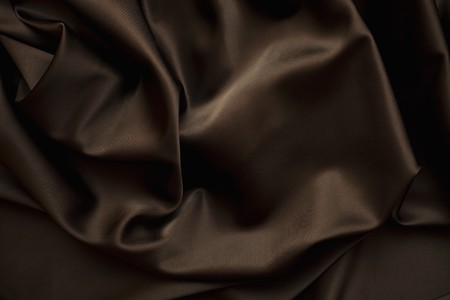 brown clothes: texture of cloth Chocolate brown satin  silk close up Stock Photo