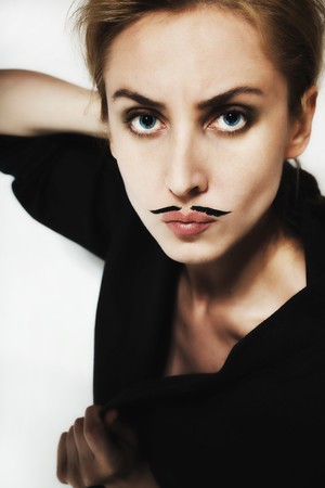 beautiful young woman with  painted mustache wearing jacket Imagens