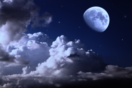 night sky with the moon, clouds and stars photo
