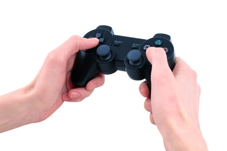 video game controller in hand isolated on white background photo