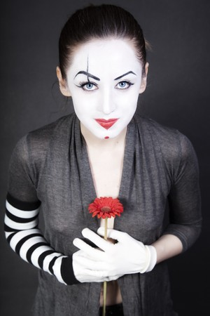 woman  mime with  red flower Stock Photo - 7338178