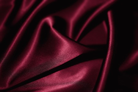 material: Texture of a red silk closeup