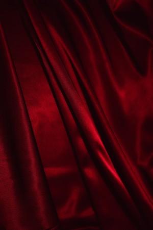 burgundy background: Texture of a red silk closeup