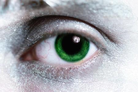 beautiful man green eye  with bright make-up around  closeup photo