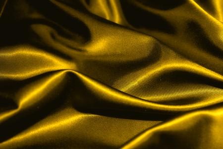 structuur van een goud satijn extreme close-up  Stockfoto