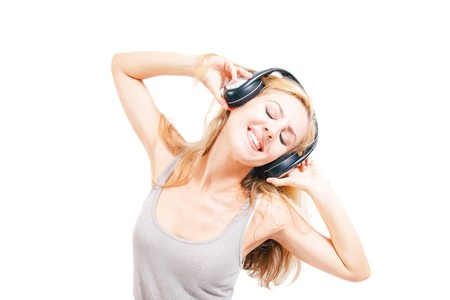 woman listening to music: young woman singing with headphones isolated on white background Stock Photo