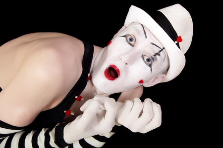 mime in striped gloves and white hat isolated on black background closeup photo
