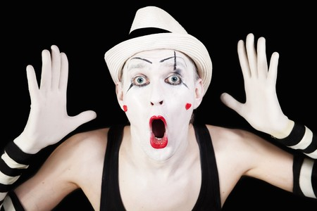 mime in striped gloves and white hat on black background Stok Fotoğraf