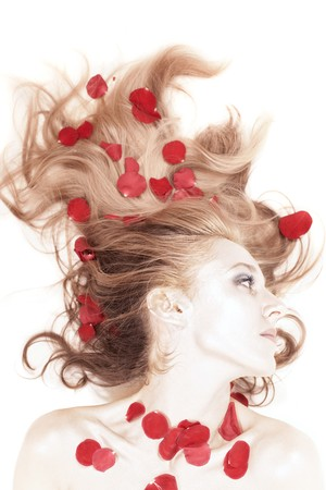 beautiful woman with rose petals in her hair