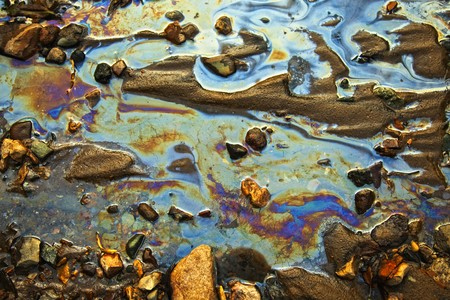 tailings: water with different colored patches of gasoline and oil