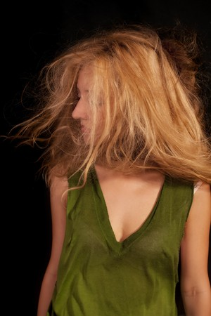 young beautiful woman with disheveled curly hair photo