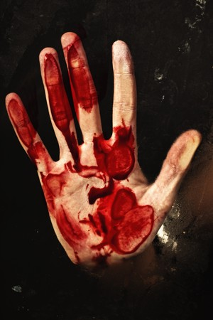 symbol victim: Human hand with blood. Halloween theme.  Stock Photo