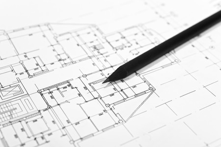 housing plan: plans for residential flats with pencil closeup