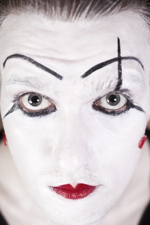 mime face with  theatrical makeup closeup photo