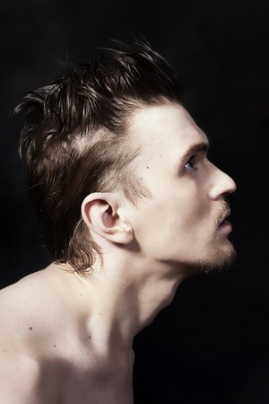 man face profile: Profile of a young handsome man on black background