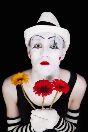 mime: mime in white hat with bouquet of red gerberas