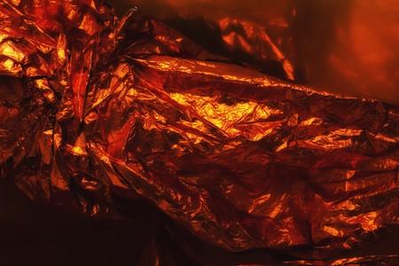 texture orange crumpled foil in closeup Stock Photo - 7754310