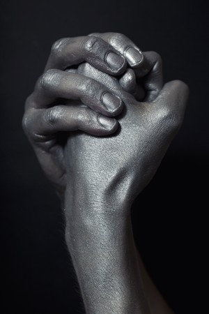 beautiful male hands in silver paint on  black background Stock Photo - 7754304