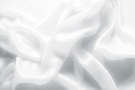 white fabric texture: delicate waves of satin silk close up Stock Photo