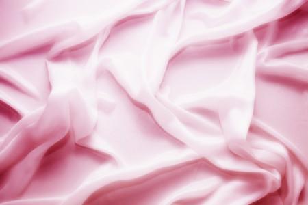 delicate waves of pink satin silk close up Standard-Bild