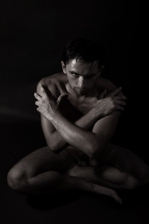 handsome young naked man sitting on the floor Stock Photo - 7872022