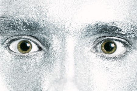 dilated pupils: green male eyes with dilated pupil closeup Stock Photo