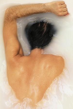 back naked suntanned young men take bath photo
