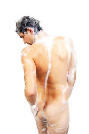 uomo nudo: Giovane uomo nudo nella schiuma di prendere una doccia con un bel corpo isolato su sfondo bianco  Archivio Fotografico