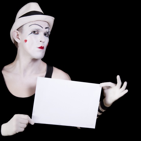 mime in striped gloves and white hat holding white blank photo